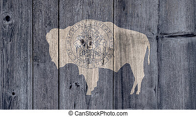 USA Politics News Concept: US State Wyoming Flag Wooden Fence