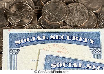 USA Social security cards laid on quarter coins