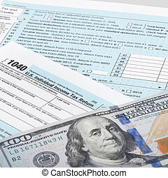 USA Tax Form 1040 with calculator and 100 dollars bills - 1 to 1 ratio