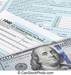 USA Tax Form 1040 with calculator and 100 US dollar bills - 1 to 1 ratio