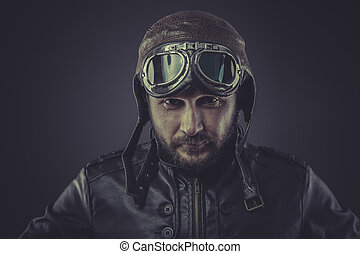 usaf pilot dressed in vintage style leather cap and goggles