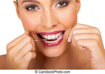 usando, dentale, donna, giovane, filo seta