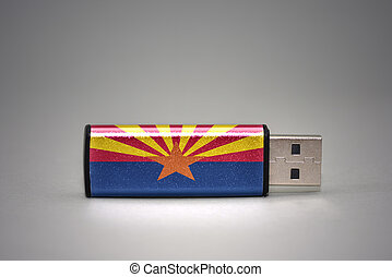 usb flash drive with the arizona state flag on gray background.