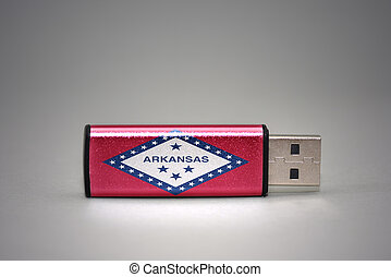 usb flash drive with the arkansas state flag on gray background.