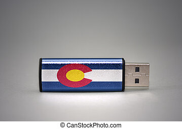 usb flash drive with the colorado state flag on gray background.