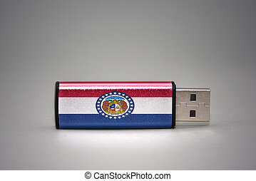 usb flash drive with the missouri state flag on gray background.
