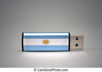 usb flash drive with the national flag of argentina on gray background.