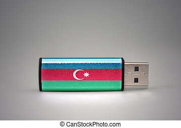 usb flash drive with the national flag of azerbaijan on gray background.
