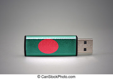usb flash drive with the national flag of bangladesh on gray background.