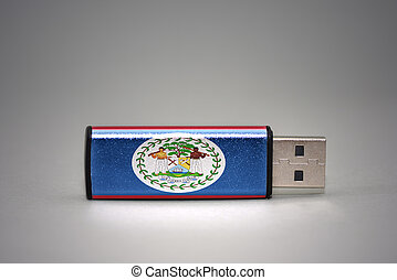 usb flash drive with the national flag of belize on gray background.