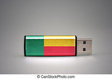 usb flash drive with the national flag of benin on gray background.