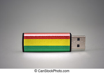 usb flash drive with the national flag of bolivia on gray background.