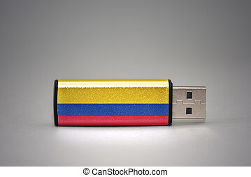usb flash drive with the national flag of colombia on gray background.