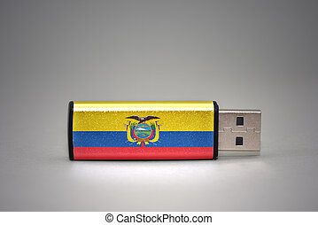usb flash drive with the national flag of ecuador on gray background.