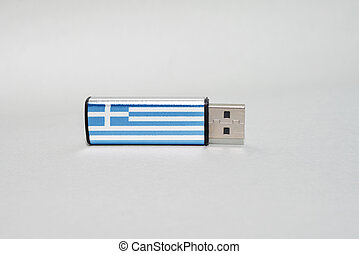 usb flash drive with the national flag of greece on gray background