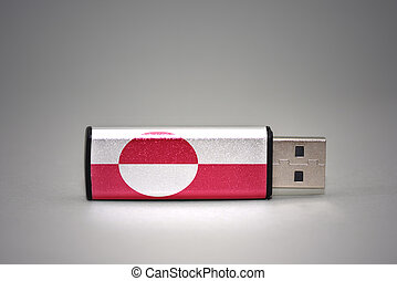 usb flash drive with the national flag of greenland on gray background.