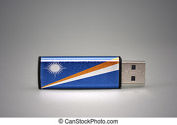 usb flash drive with the national flag of Marshall Islands on gray background.