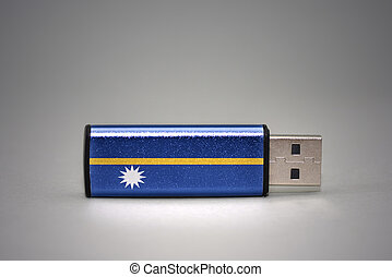 usb flash drive with the national flag of Nauru on gray background.