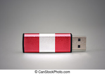 usb flash drive with the national flag of peru on gray background.