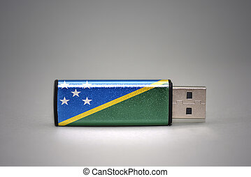 usb flash drive with the national flag of Solomon Islands on gray background.
