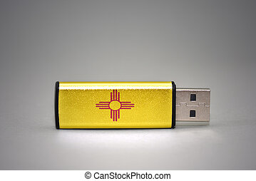 usb flash drive with the new mexico state flag on gray background.
