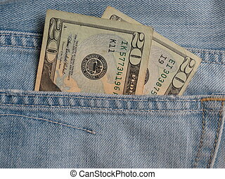 American blue jeans pocket filled with USD banknotes money