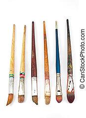 Used artist brushes isolated on white