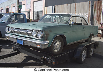 Used Car - An old used car on a flatbed trainler.