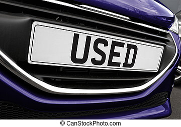 Number plate of a used cars for retail sale on a motor dealers forecourt all logos removed
