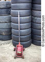 used car tires pile in the tire repair shop yard.