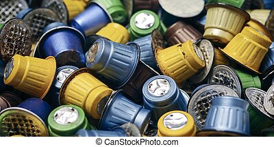 Used coffee capsules. Panoramic image with focus on foreground.