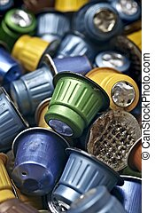 Used coffee capsules. vertical image with focus on foreground.