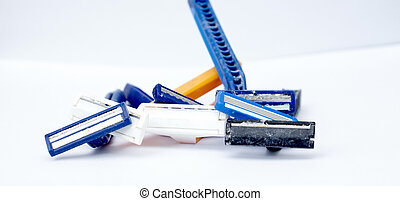 used disposable razor blade, on white background,
