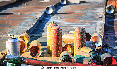 Used graffiti spray cans laying around