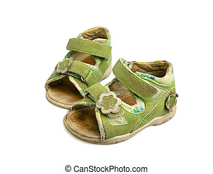 Used green child sandals isolated on white