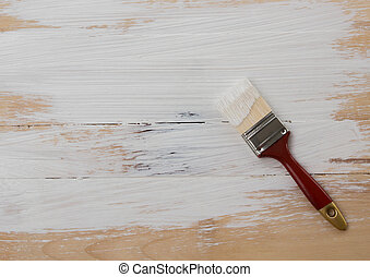 Used paint brush on wooden floor background