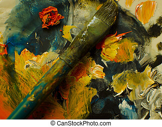 Used paintbrush - Old used paintbrush with coloured palette...