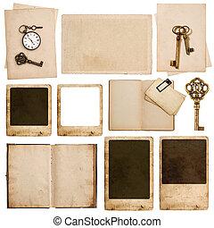 Used paper sheets, photo frames, vintage pocket watch key