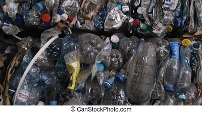 Used plastic bottles at garbage recycling processing factory...
