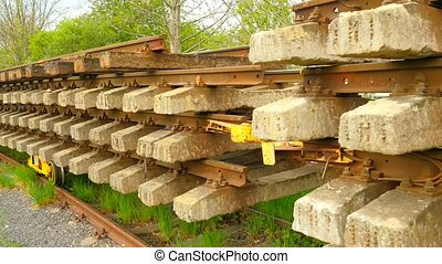 Used sleepers stock on wagon in depot. Old, dirty and rusty...