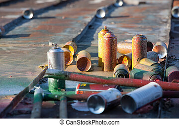 Used spray cans in a roof