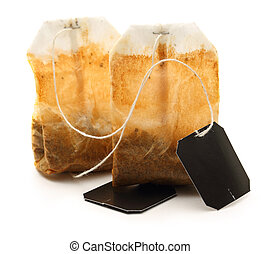 Used tea bags with label on white