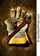 Used work gloves - Used work glove with old rusty wrench