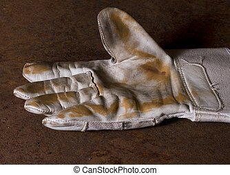 used working glove with brown background