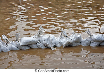 useless wall of sandbags to fend off raging river