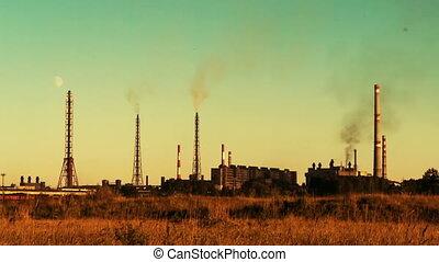 usine sidérurgique, coucher soleil