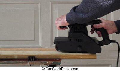 belt sander - using a belt sander to finish a pine board