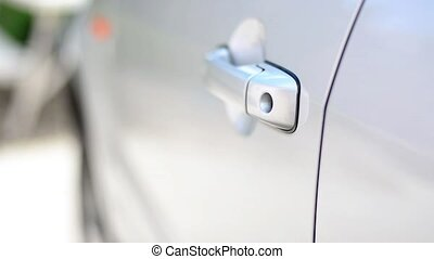Using a key to unlock a car door - Key is incerted into a...