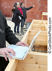 Using a laptop on construction site