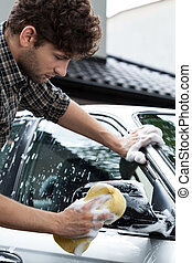 Using a sponge for cleaning car